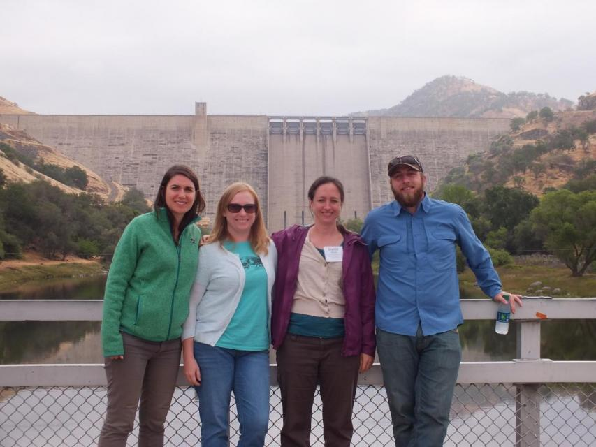 Tour guests in front of Friant Dam
