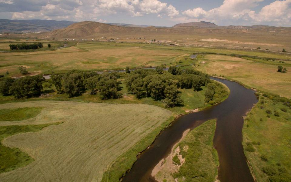 The Upper Colorado River meanders through the high plateau around Kremmling, Colorado.