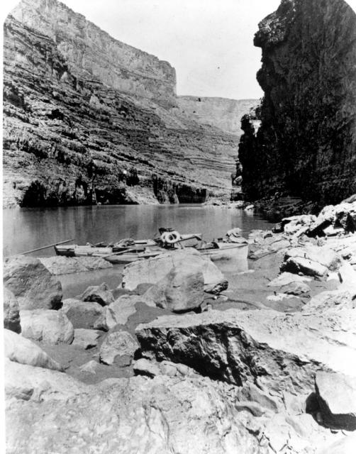 Boats of Powell's second expedition down the Colorado River in Marble Canyon. Note the armchair and life preservers.