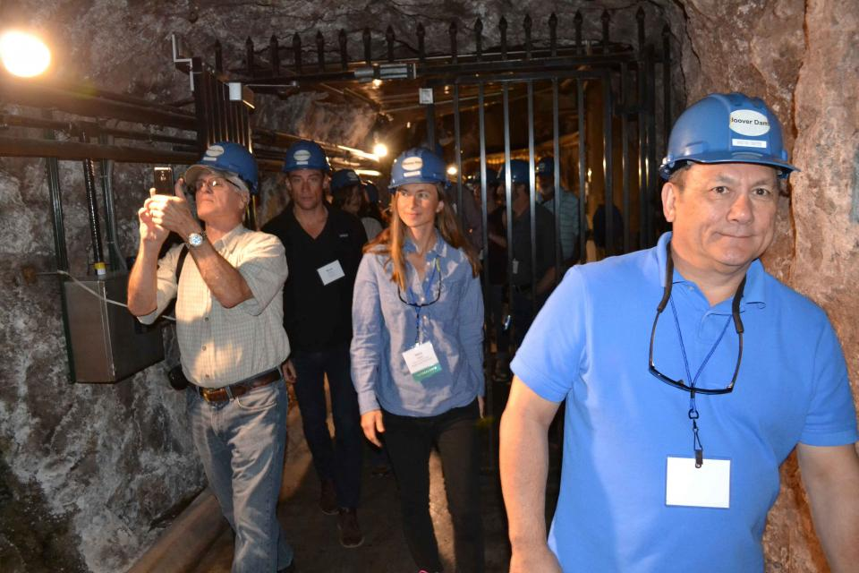 Tour group visits underground chamber at Hoover Dam.
