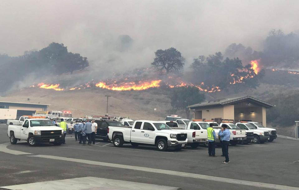 Flames from the 2018 Woolsey Fire approach Las Virgenes Municipal Water District buildings.