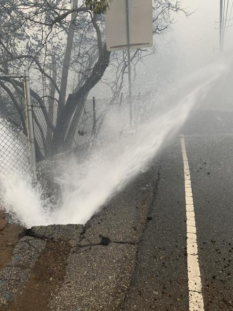 A water line ruptured in the Woolsey Fire. Crews from Las Virgenes Municipal Water District were kept busy repairing ruptured water lines during the fire.