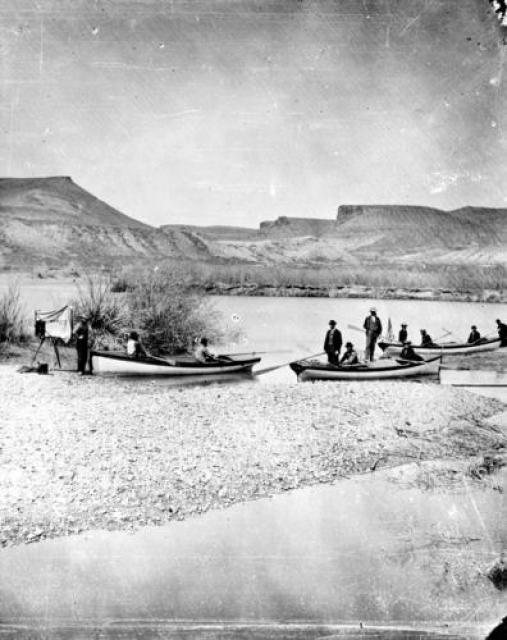 Boats from Powell's second expedition down the Colorado River, pulled up on shore.