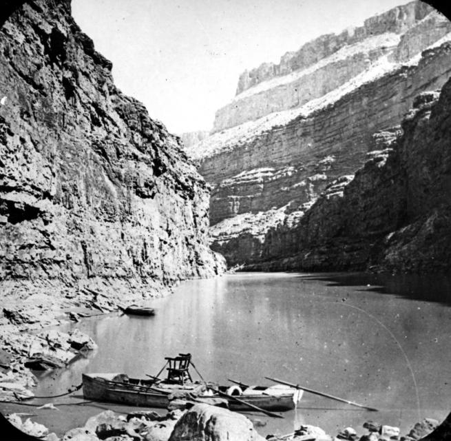 A stopover during Powell's second expedition down the Colorado River. Note Powell's chair atop the center boat.