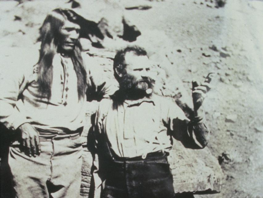 Explorer John Wesley Powell and Paiute Chief Tau-Gu looking over the Virgin River in 1873.