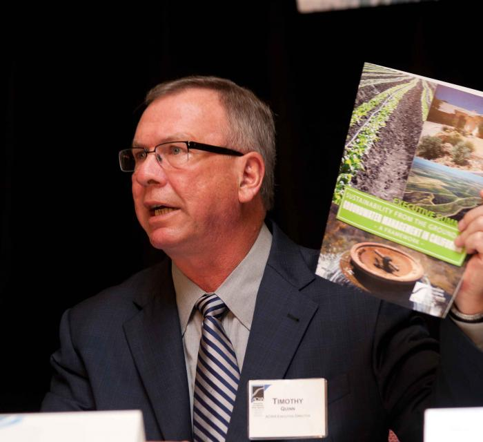ACWA Executive Director Tim Quinn  with a report produced by Association of California Water Agencies on  sustainable groundwater management.  (Source:  Association of California Water Agencies)