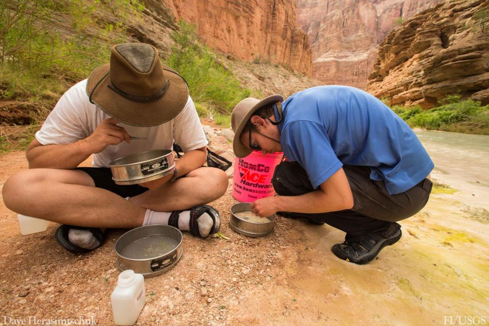 USGS scientists Josh Smith and Jeff Muehlbauer collect samples of aquatic insects from Havasu Creek, Grand Canyon, Ariz..