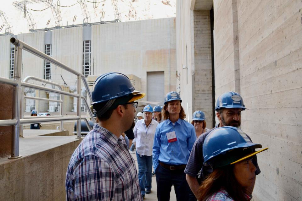 Tour group explores a part of Hoover Dam.