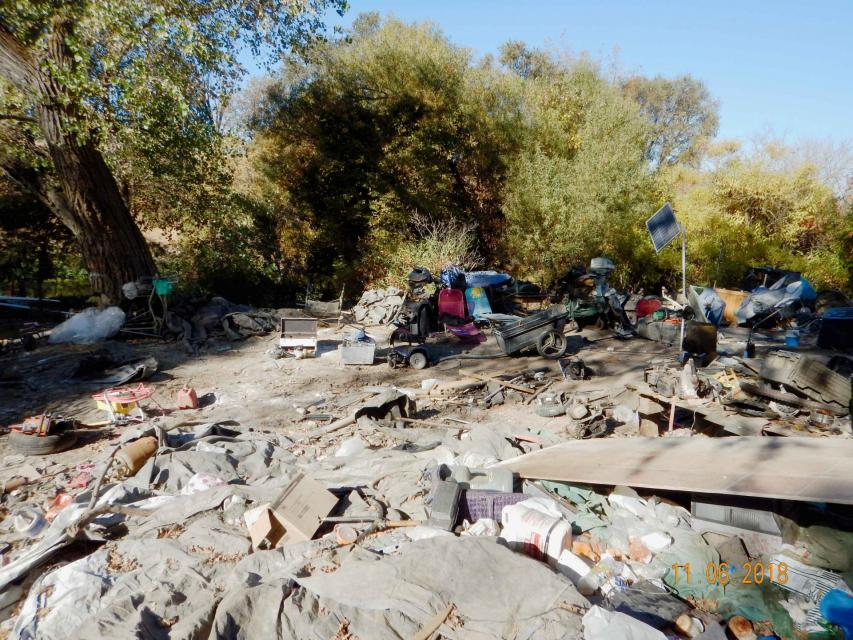 Trash is piled up at a homeless encampment along Sacramento's Steelhead Creek in 2018. Steelhead Creek is used by fall run Chinook salmon and Steelhead trout on their way to Dry Creek to spawn.  An estimated 120,000 pounds of trash were removed.