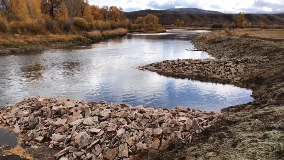 Strategic placement of rocks promotes a more natural streamflow that benefits ranchers and fish.