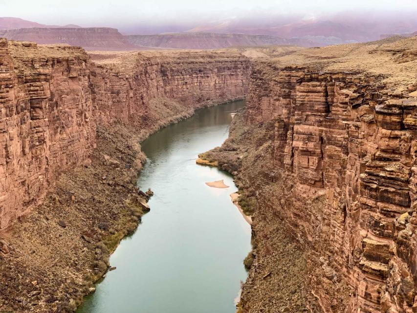 The Colorado River threading its way through a desert canyon near Lee Ferry, Arizona.