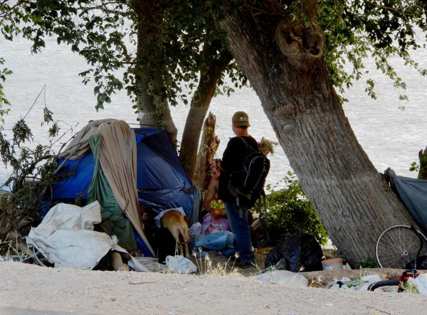 A homeless camp set up along the Sacramento River near downtown Sacramento.